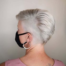 old lady showing her short styled hair
