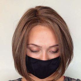 woman wearing a mask with short styled hair