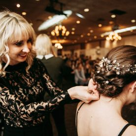 Woman adjusting hair styled for a large event